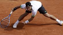 Italy's Fabio Fognini slips on the clay as he plays as he plays Spain's Albert Montanes during their fourth round match. Fognini won 4-6, 6-4, 3-6, 6-3, 11-9. (AP Photo/Lionel Cironneau) (Lionel Cironneau/AP)