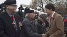 Justin Trudeau shakes hands with Canadian veterans following a Remembrance Day ceremony at the National War Memorial in Ottawa on Nov. 11, 2015. (Adrian Wyld/THE CANADIAN PRESS)