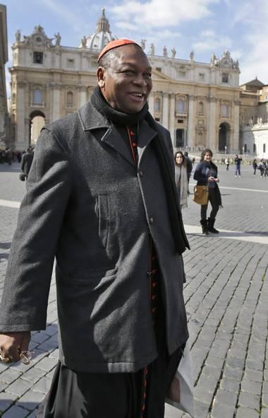 Cardinal John Olorunfemi Onaiyekan, of Nigeria, leaves after a cardinals' meeting, at the Vatican, Monday, March 4, 2013. (Andrew Medichini/AP)