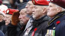 A veteran salutes during the Remembrance Day ceremony at the National War Memorial in Ottawa November 11, 2013. (CHRIS WATTIE/REUTERS)