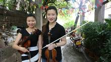 She Xiaoxue and Shi Shuai, violin players on tour with Canada's NAC orchestra, came to Chongqing as classical music rises in popularity. (Nathan VanderKlippe)