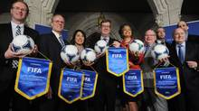 City representatives help FIFA and the Canadian Soccer Association announce the host cities for the 2015 FIFA Women's World Cup on Parliament Hill in Ottawa on Friday. (Sean Kilpatrick/The Canadian Press)
