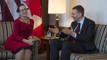 Minister of Foreign Affairs Chrystia Freeland speaks with Latvian Foreign Affairs Minister Edgars Rinkevics in Ottawa on March 23, 2017. (Adrian Wyld/THE CANADIAN PRESS)