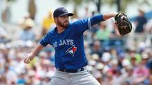 Toronto Blue Jays starting pitcher Drew Hutchison throws a pitch during the first inning against the Tampa Bay Rays in a spring training game in Port Charlotte, Fla., on Sunday. (Kim Klement/USA Today Sports)