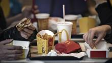 Customers dine inside a McDonald's Corp. restaurant in Shanghai, China, on Friday, Jan. 13, 2017. (Qilai Shen/Bloomberg)
