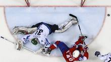 Norway's Ken Andre Olimb scores a goal against Finland's goaltender Petri Vehanen during their quarter-final match at the Ice Hockey World Championships in Bratislava. (GRIGORY DUKOR/Reuters)
