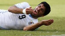 Uruguay's Luis Suarez reacts after clashing with Italy's Giorgio Chiellini during their 2014 World Cup Group D soccer match at the Dunas arena in Natal June 24, 2014. REUTERS/Tony Gentile (BRAZIL - Tags: SPORT SOCCER WORLD CUP TPX IMAGES OF THE DAY TOPCUP) (TONY GENTILE/REUTERS)