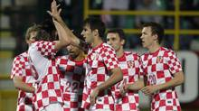Croatian's Nikola Kalinic (14) celebrates with teammates during their friendly soccer match against Estonia at Aldo Drosina Stadium in Pula May 25, 2012. (Reuters)