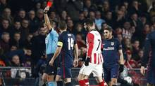 PSV's Gaston Pereiro, centre, is shown a red card during a Champions League round of 16 match against Atletico Madrid in Eindhoven, Netherlands, on Feb. 24. (Peter Dejong/AP Photo)