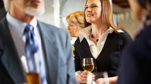 Corporate visits can be as formal as a plenary session or as informal as Tuck's strategy of ordering wine, hiring a sommelier and inviting a group of investment bankers to visit, while career coaches circulate. (Photos.com/Getty Images)