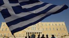 Swiftly-denied rumours of tax plans hammered Greek sovereign debt, and the selling spread across the euro zone periphery. (JOHN KOLESIDIS/REUTERS)