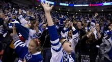 Leafs fans celebrate at the end of the Toronto Maple Leafs 2-1 win over the Boston Bruins during game six of the first round NHL Stanley Cup Playoff at the Air Canada Centre in Toronto on May 12, 2013 (Peter Power/The Globe and Mail)