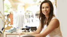 Female Sales Assistant At Checkout Of Clothing Store (Catherine Yeulet/Getty Images/iStockphoto)