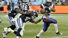 Montreal Alouettes running back Brandon Whitaker, right, scores a touchdown behind Toronto Argonauts defenders Pacino Horne and Raymond Brown during the first half of their CFL football preseason game in Toronto June 19, 2012. (MIKE CASSESE/REUTERS)