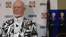 Hockey commentator Don Cherry stands next to his bobblehead doppelganger at a news conference in Calgary on Friday, Feb. 18, 2011. (Bill Graveland/THE CANADIAN PRESS)