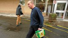 Darrell Johnson leaves with a case of Alexander Keith's beer at the Nova Scotia Liquor Commission store on Agricola street in Halifax, NS, November 23, 2010. (Paul Darrow for The Globe and Mail/Paul Darrow for The Globe and Mail)