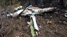 A wing is seen among the wreckage of a Cessna Citation, which crashed on Friday. (THE CANADIAN PRESS)
