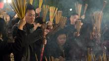 Worshippers just before midnight at International Buddhist Temple in Richmond, B.C., on February 9, 2013, where they pray with joss sticks (Incense Sticks) for a happy and prosperous New Year as Chinese around the world celebrate the year of the Snake. (JOHN LEHMANN/The Globe and Mail)