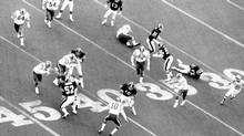 Bill Hatanaka of the Rough Riders heads downfield to score Ottawa's first touchdown at the 1976 Grey Cup in Toronto. As Hatanaka describes it, 'punt return left, the ball bounced once and once I moved by the first tackler, it was truly as if the seas had parted.' (John Maiola For The Globe and Mail)