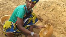 Because a severe drought in the Sahel region of West Africa has left them with no other income this year, a rising number of impoverished people are trekking to the small informal gold pits of Burkina Faso, where they scavenge for tiny flecks of gold. This 15-year-old girl is working all day in the gold pits, rather than being in school. (Geoffrey York/The Globe and Mail)