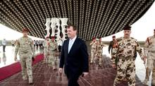 Foreign Minister John Baird walks away after laying a wreath at Iraq's Tomb of the Unknown Soldier in Baghdad, April 1, 2013. on Monday. (Wathiq Khuzaie for The Globe and Mail)