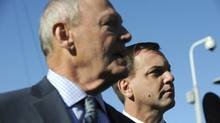 Ontario PC Leader Tim Hudak, right, is pictured with MPP Doug Holyday. The provincial Tories are siding with Toronto council over the preferred route for the Scarborough subway extension and demanding Queen's Park do the same. (Fred Lum/The Globe and Mail)
