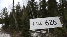 A sign marking one of the many lakes that are part of the Experimental Lakes Area near Kenora, Ont., is photographed Nov 1 2012. The research facility examines, using experimental lakes, the effect of human activities on lakes and their watersheds. (Fred Lum/The Globe and Mail)