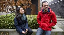 Christine Maria Gamboa, left, and Syrian refugee Ali Tisso meet for the first time in Vancouver. (Ben Nelms for The Globe and Mail)