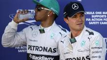 Mercedes Formula One driver Nico Rosberg of Germany (R) stands next to teammate Mercedes Formula One driver Lewis Hamilton of Britain after Rosberg took pole position in the qualifying session of the Monaco F1 Grand Prix in Monaco May 24, 2014. (MAX ROSSI/REUTERS)