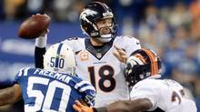 Denver Broncos quarterback Peyton Manning (18) throws a pass against the Indianapolis Colts during the first half at Lucas Oil Stadium on Sunday night. (USA Today Sports)