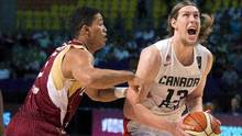Canada's Kelly Olynyk, left, looks to shoot under pressure from Venezuela's Windi Graterol, during a FIBA Americas Championship basketball game in Mexico City, Friday, Sept. 11, 2015. (Eduardo Verdugo/THE ASSOCIATED PRESS)