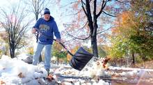 Jim Nisula of Doylestown, Pennsylvania shovels snow and ice outside his home after a winter storm October 30, 2011 in Doylestown, Pennsylvania. (Getty Images/William Thomas Cain/Getty Images/William Thomas Cain)