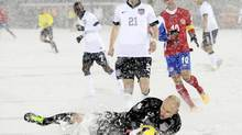 Goalkeeper Brad Guzan of the U.S. makes a sliding stop in the snow during their 2014 World Cup qualifying soccer match against Costa Rica in Commerce City, Colorado March 22, 2013. Costa Rica is protesting their 1-0 loss due to the playing conditions. (MARK LEFFINGWELL/REUTERS)