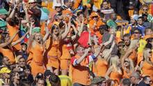 Some 36 women from the Netherlands dressed up as Danish supporters before stripping down to reveal the orange miniskirt designed by Dutch beer brewer Bavaria at Soccer City stadium. Three Dutch women were held and questioned for three hours. The Dutch foreign ministry has asked the South African authorities to explain why the women were forcibly removed from the stadium. (REUTERS)