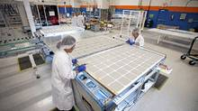 Workers at Silfab, an Ontario-based company specializing in photovoltaic technology, manufacture solar panels at a facility in Mississauga. (Kevin Van Paassen/The Globe and Mail)