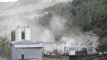 Smoke rises from one of the entrances of the mine where an explosion occurred in Soma, a district in Turkey's western province of Manisa May 14, 2014. (Gokhan Gungor/REUTERS)