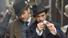 Robert Downey Jr. as Holmes (right) and Jude Law as Watson. (ALEX BAILEY/© 2009 Warner Bros. Entertainment Inc. - - U.S., Canada, Bahamas & Bermuda?© 2009 Village Roadshow Films (BVI) Limited - - All O)