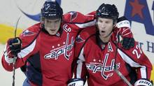 Washington Capitals' Mike Knuble (22) celebrates with teammate Alex Ovechkin, left, of Russia, after scoring a goal against Columbus Blue Jackets goalie Steve Mason during the second period of an NHL hockey game Thursday, March 31, 2011, in Washington. (Luis M. Alvarez/AP)