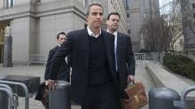 SAC Capital Advisors trader Michael Steinberg, centre, leaves court Friday, released on a $3-million (U.S.) bond. (KEITH BEDFORD/REUTERS)