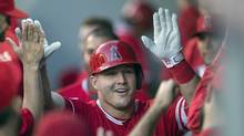 FILE - In this Sept. 3, 2016, file photo, Los Angeles Angels' Mike Trout is congratulated by teammates after hitting a solo home run off Seattle Mariners starter Taijuan Walker during the first inning of a baseball game, in Seattle. Trout, was named the American League's Most Valuable Player. (Stephen Brashear/AP)