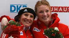 Pilot Kaillie Humphries (L) and Heather Moyse of Team Canada 1 celebrates after the final run of the women's Bobsleigh World Championship on February 19, 2011 in Koenigssee, Germany. (Alexander Hassenstein/2011 Getty Images)