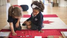 Grade 1 and 2 students at Liberty Prep Montessori school in Toronto learn numbers and letters through tactile methods. (J.P. MOCZULSKI FOR THE GLOBE AND MAIL)