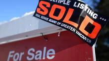 A real estate sold sign is shown outside a house in Vancouver, on Jan.3, 2017. (Jonathan Hayward/THE CANADIAN PRESS)