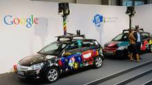 Cars equiped with special cameras, used to photograph whole streets, can be seen on the Google street view stand at the world's biggest high-tech fair, the CeBIT on March 3, 2010 in the northern German city of Hanover. (DANIEL MIHAILESCU/AFP/Getty Images)