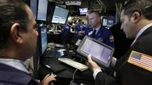 Traders work on the floor of the New York Stock Exchange Wednesday, March 16 (AP)