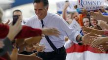 Republican presidential nominee Mitt Romney takes the stage at a campaign rally at the airport in Sanford, Florida November 5, 2012. (BRIAN SNYDER/REUTERS)