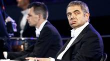 Actor Rowan Atkinson, known for his role as Mr. Bean, performs during the opening ceremonies of the London 2012 Olympic Games at the Olympic Stadium July 27, 2012. (KAI PFAFFENBACH/REUTERS)