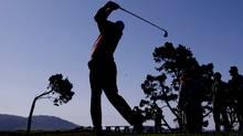 Silhouette of a golfer (Eric Risberg/Associated Press)