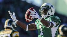 Saskatchewan Roughriders running back Kory Sheets celebrates after scoring a touchdown during the first half of their CFL football game against the Edmonton Eskimos in Regina, Saskatchewan October 12, 2013. Saskatchewan face B.C. in a key Week 17 West Division battle. (REUTERS)