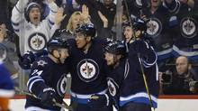 Winnipeg Jets' Kyle Wellwood, second from the right, celebrates his goal against the New York Islanders with, from left, Grant Clitsome, Evander Kane and James Wright during the second period of their NHL hockey game in Winnipeg April 20, 2013. (FRED GREENSLADE/REUTERS)